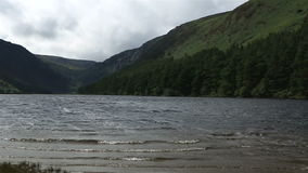 Upper Lake after rain in Glendalough stock video footage