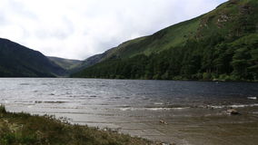 Upper Lake after rain in Glendalough stock video