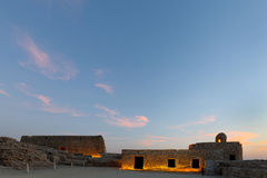 Upper level of Bahrain Fort during dusk Stock Photos