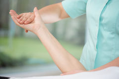 Upper limb exercise. Close-up of physiotherapist doing upper limb exercise royalty free stock images
