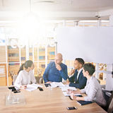 Upper management discussing stratergy at their weekly sunrise meeting Royalty Free Stock Photo