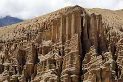 Mountain relief formed during weathering, in the gorge between Ghami and Dhakmar. Upper Mustang. Nepal. Mountain relief formed during weathering, in the gorge Stock Images