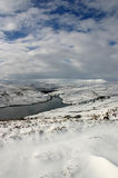 Upper Nidderdale. In the Yorkshire Dales, England, in the snow, with Scar House Reservior and the dam in the distance Royalty Free Stock Image