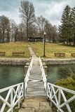 Upper Onondaga Park in Syracuse Upstate New York, USA. A Bridge over The Water Leading to The Wood Stock Image
