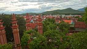 Upper Panorama of Large Buddhist Temple Complex by River. Against hilly landscape and cloudy sky in Vietnam stock video