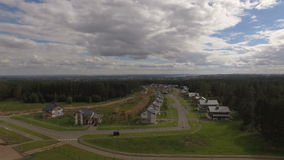 Upper Panoramic View Cottage Village among Forest stock footage
