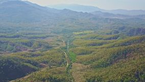 Upper Panoramic View Jungle Valley Mountains in Background stock video