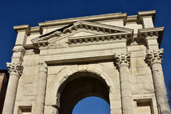 Upper part of Arco dei Gavi. Detail from the ancient triumph arch in the center of Verona, Italy Stock Image