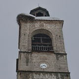 Upper part of clock tower at church in Bansko town Royalty Free Stock Images