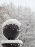 Upper part of the column. Upper part of the fence column covered with snow, close-up Royalty Free Stock Photo