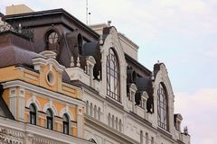 The upper part of the facade of an old house. In the square of Bogdan Khmelnitsky Stock Photo