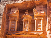 Upper part of facade The Treasury temple in Petra Stock Photography