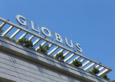 Upper part of the Globus store building in Zurich. Zurich, Switzerland - 6 August, 2015: upper part of the Globus store building. Globus is a Swiss department Royalty Free Stock Photo