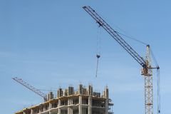The upper part of the house under construction and a crane stock photo