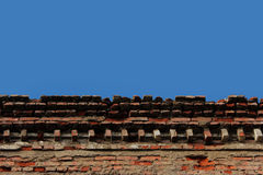 Upper part of the old brick building against the sky. Stock Photography