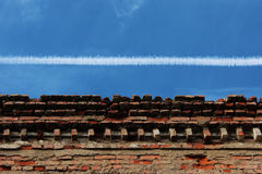 Upper part of the old brick building against the sky. Royalty Free Stock Photos