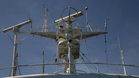 Upper part of a ship. Still shot of communication and navtic system on a ship stock video