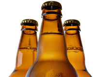 Upper part of three beer bottles. Isolated over white background royalty free stock photos