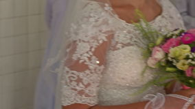 Upper Part of White Lacy Dress on Bride with Bouquet. Closeup upper part of elegant white lacy wedding dress on beautiful caucasian bride with colourful bunch of stock video