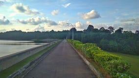 Upper Peirce Reservoir park. Road divider between Upper Peirce Reservoir and Lower Peirce Reservoir in Singapore Stock Photo