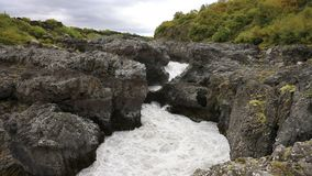 The upper reaches of the waterfall Barnafoss stock video