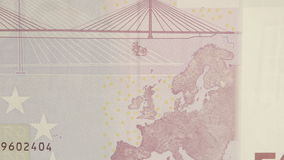 The upper right detail of the 500 Euro bill. Showing the map and the bridge at the back stock video