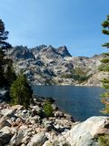 Upper Sardine Lake, Sierra Buttes. Upper Sardine Lake rests below the mighty Sierra Buttes in the Sierra Nevada Mountains of Northern California royalty free stock photos