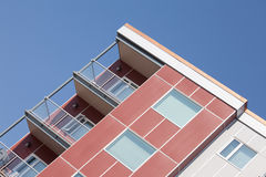 Upper story corner high rising apartment building Stock Photography