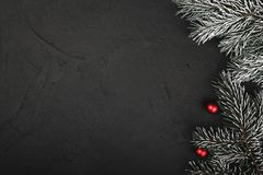 Upper, top view, of Christmas presents on a wooden black rustic background. Upper, top view, of Christmas presents on a wooden black rustic background, with Royalty Free Stock Photo