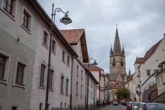 Upper town of Sibiu, in Transylvania, during a cloudy afternoon in a medieval street of the city. Royalty Free Stock Images