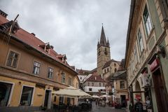 Upper town of Sibiu, in Transylvania, during a cloudy afternoon in a medieval street of the city. Royalty Free Stock Photo