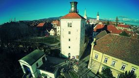 Upper Town Zagreb - aerial. ZAGREB, CROATIA - DECEMBER 22, 2014: Aerial shot of the Upper town old buildings Funicular and Lotrscak Tower while people walking stock footage