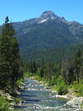 Upper Trinity River. Looking south at Billy's Peak (northern part of the Trinity Alps) with the Trinity River flowing above Trinity Lake Royalty Free Stock Image