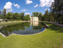 Upper Trough or Mylnya of Their Highnesses pavilion on the bank of the Mirror pond. Catherine Park. Pushkin Stock Image