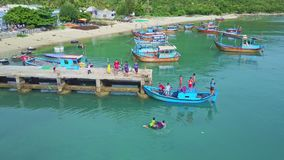 Upper View Asian Children Jump from Boat into Sea stock footage