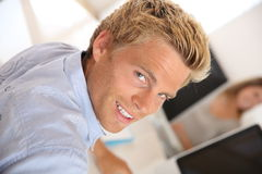 Upper view of blond man working in agency. Training period in advertisement agency Stock Photography