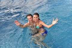 Upper view of cheerful couple in swimming pool Royalty Free Stock Photography