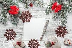 An upper view of a Christmas, new year letter, card writing, on a rustic background, with old style pencil. Royalty Free Stock Photos