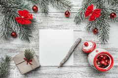 An upper view of a Christmas, new year letter, card writing, on a rustic background, with old style pencil. Royalty Free Stock Photo