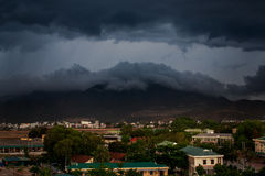 upper view of city dark thunderclouds above city mountains Stock Image