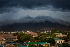 upper view of city dark thunderclouds above city mountains Stock Images