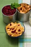 Upper view on glass bowl full of cornflakes with berries Stock Images