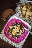 Upper view of a lithuanian cold beetroot soup. With greens and eggs, served with hot potatoes and bread Stock Image