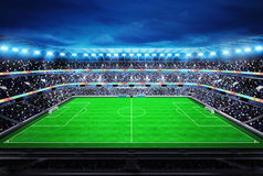Upper view on modern football stadium with fans in the stands Royalty Free Stock Photography
