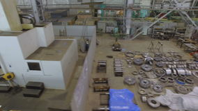 Upper View Plant Workshop with Equipment and Construction. KAZAN, TATARSTAN/RUSSIA - JUNE 12 2016: Upper view spacious plant workshop with metal parts separated stock video