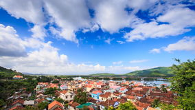 Upper View of Red Roofs Small City near River among Hills stock video footage