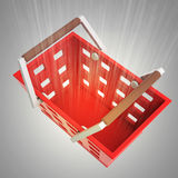Upper view on red shopping basket with flare Stock Image