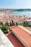 Upper view on roofs of old european marine town near sea bay Royalty Free Stock Images