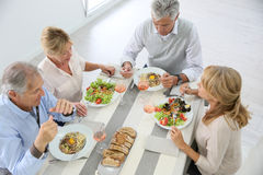 Upper view of seniors having lunch at home table Royalty Free Stock Photo