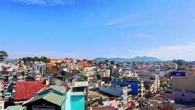 Upper View of Tropical City with Colorful Buildings. DA LAT, LAM DONG/VIETNAM - MAY 17 2016: Upper panorama of tropical city with colourful buildings against stock video footage